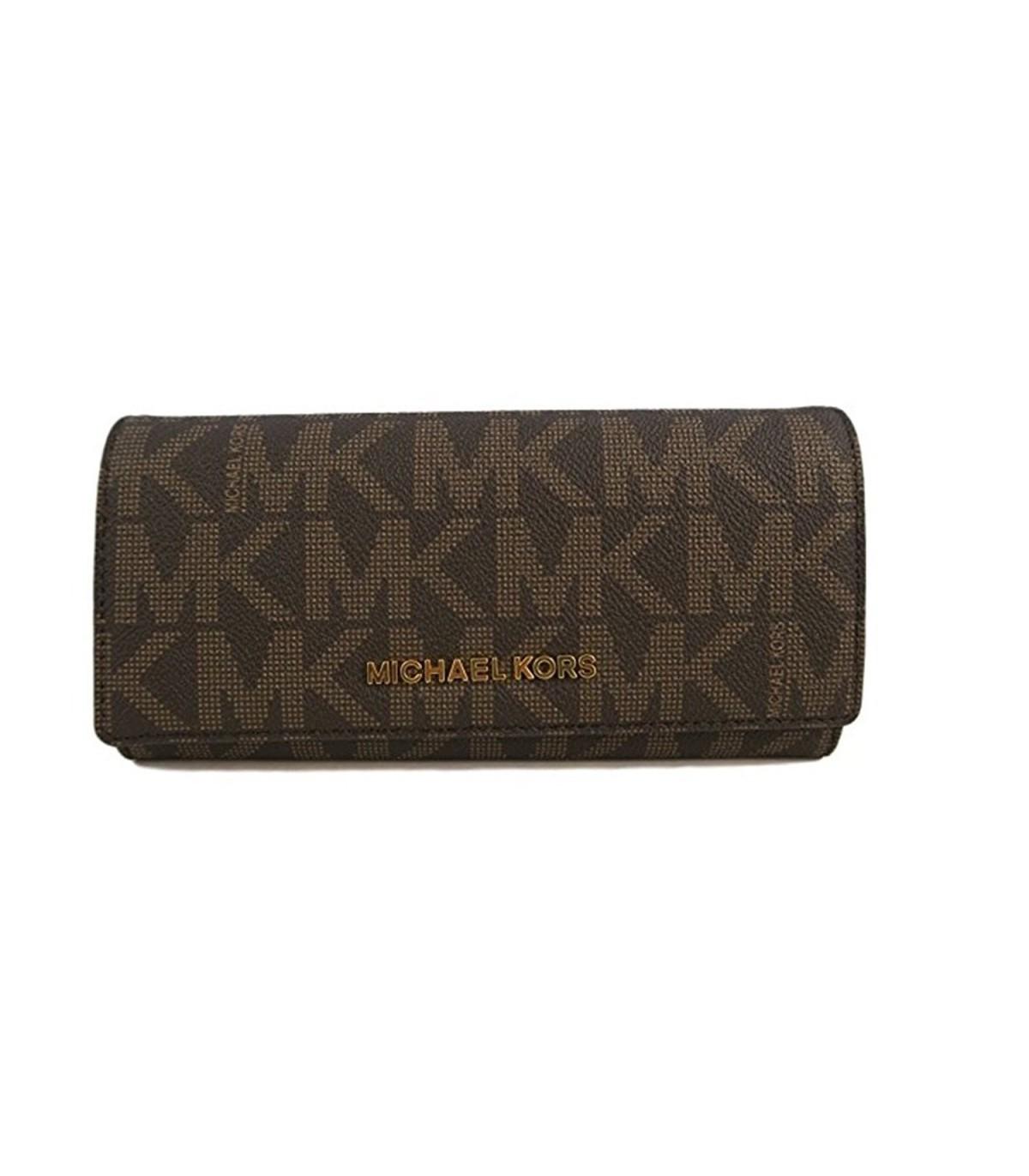 7e60f0374164 Michael Kors Jet Set Travel PVC Signature Carryall LTR Clutch Wallet in  Brown