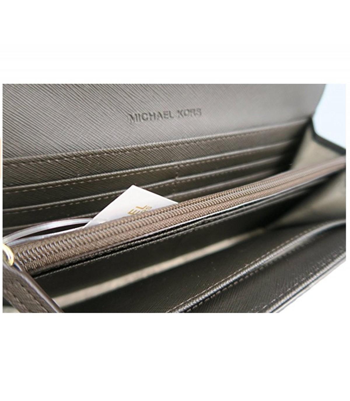72cf6f405da72d Michael Kors Jet Set Travel PVC Signature Carryall LTR Clutch Wallet in  Brown